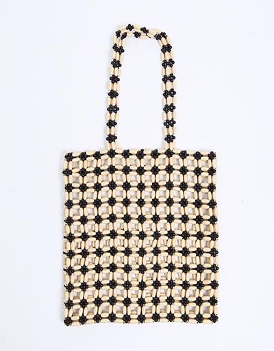 Perles, bois, raphia : les sacs tendance à adopter cet été !